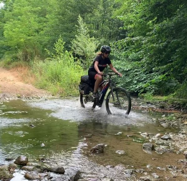 Biking in the nature, crossing a small river